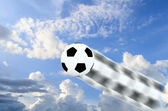 Soccer ball moving faster on blue sky, motion blur. Sport game c — Stock Photo