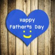 Happy Father's day word on red heart shape with wooden wall — Stock Photo #46870423