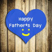 Happy Father's day word on red heart shape with wooden wall — Stock Photo