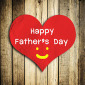 Happy Father's day word on red heart shape with wooden wall — Foto Stock