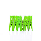 Wooden clothes pins on a white background — Stock Photo