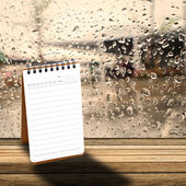 Notebook with  rainy day window background — Stock Photo