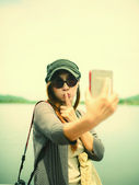 Beautiful Asian woman taken picture of herself, selfie — Stockfoto