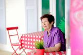 Positive mature woman at outdoor restaurant — Zdjęcie stockowe