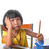 Bored child at school — Stock Photo