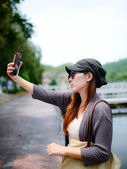 Beautiful Asian woman taken picture of herself, selfie — Stockfoto