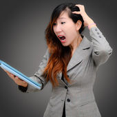 Shocked businesswoman with digital table — Stock Photo