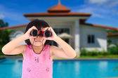 Girl with binoculars In Front of Dream House.  — Stock Photo