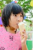 Little Asian girl enjoy her icecream — Stock Photo