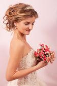Blonde bride on pink background — Stock Photo