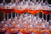Pyramid of wineglasses of red wine — Stock Photo