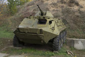The thrown armoured troop-carrier — Stock Photo