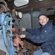 Stock Photo: Machinist operates steam locomotive