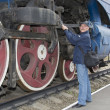 Stock Photo: Machinist repairs steam locomotive
