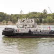 ROSTOV-ON-DON, RUSSIA-AUGUST 24 - Tug boat going down river — Stock Photo #33197503