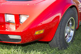 Left front fender red car parked in a meadow — Stock Photo