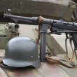German Schmeisser submachine gun and helmet on the armor of the — Stock Photo #39087619