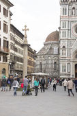 Tourists visiting the sights on the Piazza San Giovanni and del  — Stock Photo