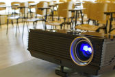Digital projector in a conference hall — Stock Photo