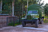 World War II military truck, shiny and as new. Birch forest — Stock Photo