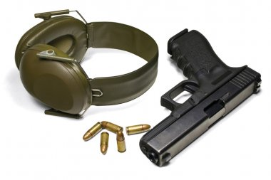 Pistol, ear protection and ammunition. Isolated on white. 3 separate clipping paths: pistol, earmuffs, ammo and 1 complete for all objects.