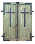 Old wooden threadbare double doors to a church built in 1740 — Stok fotoğraf