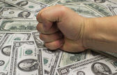 Money (federal reserve notes) and fist — Stock Photo