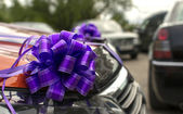The car decorated with bows as a gift or a wedding cortege car — Stock Photo