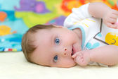 2 months old infant baby girl sucking thumb — Stock Photo