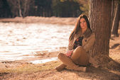 Brunette girl sitting cross-legged — Stock Photo