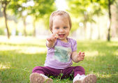 Baby outside in summer — Stock Photo