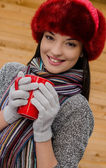 Beautiful woman having a hot tea in winter time — Stock Photo