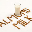 Stock Photo: Almond milk and several almonds on white background
