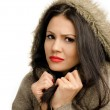 Sexy young brunette girl in autumn being cold. — Stock Photo