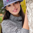 Stock Photo: Sexy young brunette girl with hat.