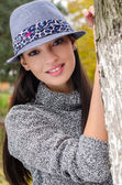 Sexy young brunette girl with hat. — Stock Photo