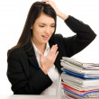 Business woman working under stressful conditions at work — Stock Photo