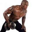 Black bodybuilder training with dumbbells. Strong man with perfect abs, shoulders,biceps, triceps and chest. Isolated on white background — Stock Photo #30799737
