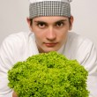 Beautiful chef promoting a green salad for a perfect healthy life — Stock Photo