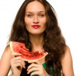 Beautiful woman eating a green ripe melon slice — Stock Photo #31197497