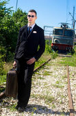 Businessman depressed after loosing his job tries to suicide on the railroad — Stock Photo