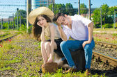 Young couple upset because they lost the train for their honeymoon vacation — Stock Photo