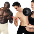 Woman lifting a heavy weight and laughing at 2 men who tries to lift a smaller dumbbell  — Stock Photo