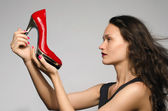Woman in love with her shoes — Stok fotoğraf