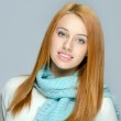 Portrait of a beautiful red hair woman wearing a blue scarf. Woman dressed for cold weather — Stock Photo #35126385