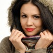 Sexy young brunette girl with red lips in autumn. Portrait of a young attractive woman wearing a sweater with faux fur hood — Stock Photo #35466615