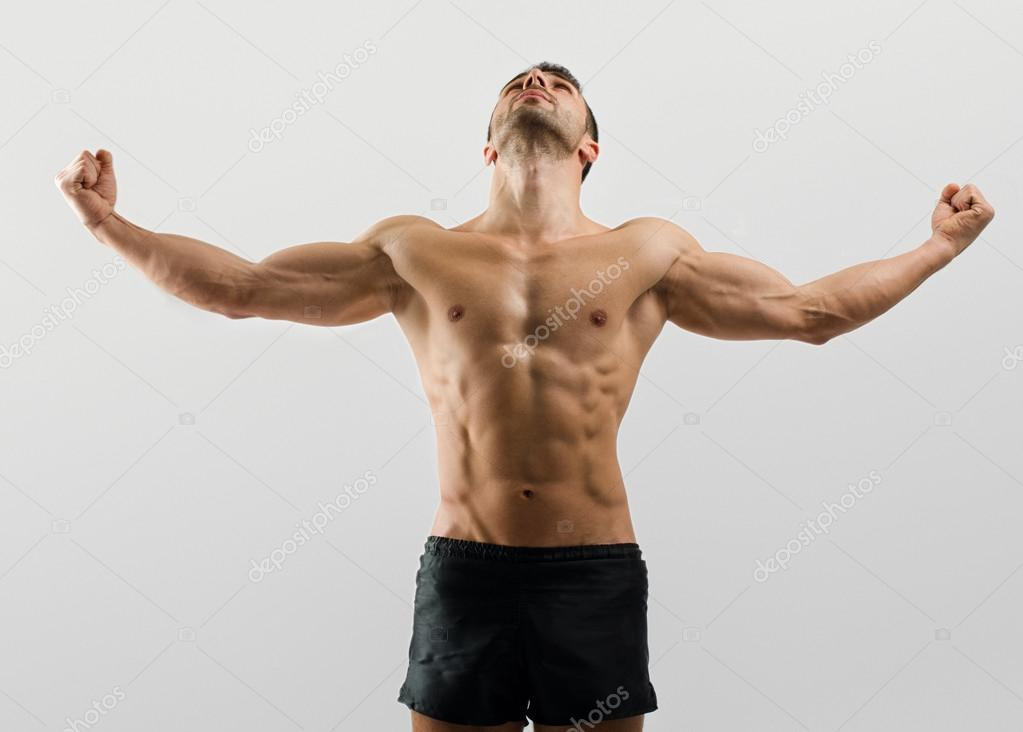 Strong Bodybuilder Man With Perfect Abs Shouldersbiceps