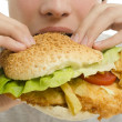 Close up of a man eating a big hamburger, fast food unhealthy burger — Stock Photo