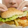Close up of a man eating a big hamburger, fast food unhealthy burger — Stock Photo #41616029