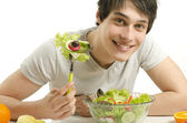Man eating organic healty salad for a perfect diet. Green food for a healthy life — Stock Photo